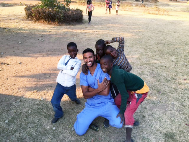 Dental student Keith Mahipala smiles with some young patients in Zambia.