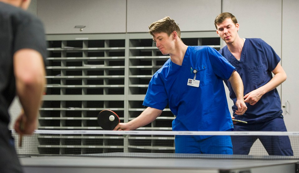 Texas A&M College of Dentistry students begin volleys on their new ping-pong table, a gift from the college Alumni Association.