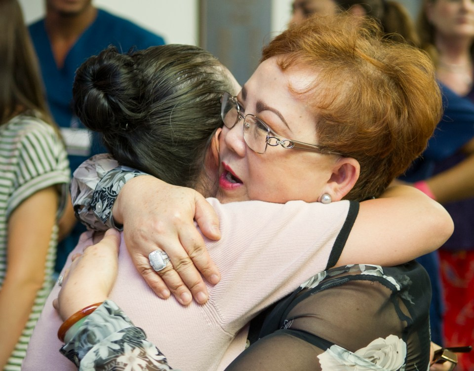 Dr. Loulou Moore receives a hug during her retirement reception