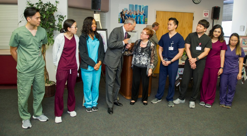 Dr. Loulou Moore presents a check to Texas A&M College of Dentistry in honor of the Asian-American Dental Society