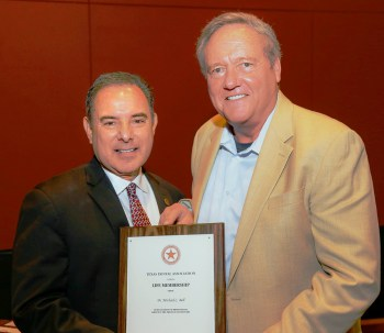 "Dr. Michael Bell, right, with Dr. Jose ""Joey"" Cazares '85, past president of the Texas Dental Association"