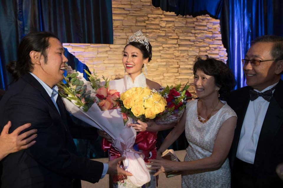 D1 Karen Yen, center, after winning the Miss Chinatown Houston scholarship pageant in July 2018.
