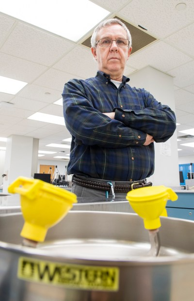 Hiram Patterson at one of the college's eyewash stations, which he inspects each week.