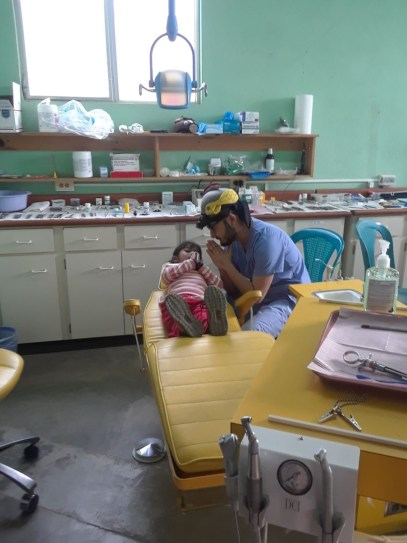 "During a March 2018 mission trip to Guatemala, DH2 Alfredo Rodriguez treated this young patient who was anxious, to say the least. ""She was scared,"" he recalls, looking at the photo, the screen saver on his phone for nearly a year. ""Sometimes as students, when we are successful, we forget about these things. It reminds me to keep my feet on the ground and to remember where I'm coming from."""