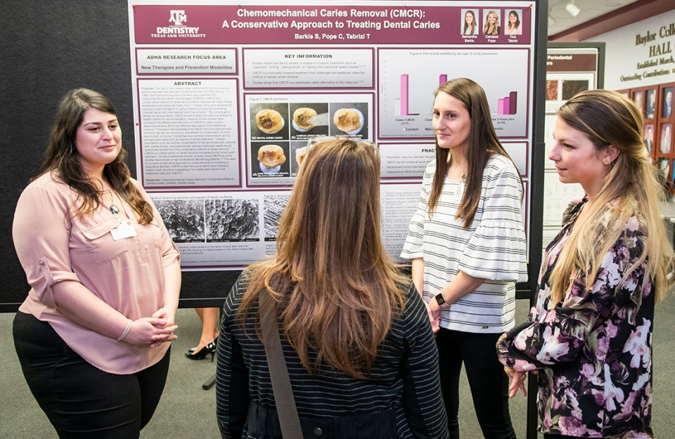 From left: Students Tina Tabrizi, Samantha Barkis and Candace Pope answer questions at Research Scholars Day.