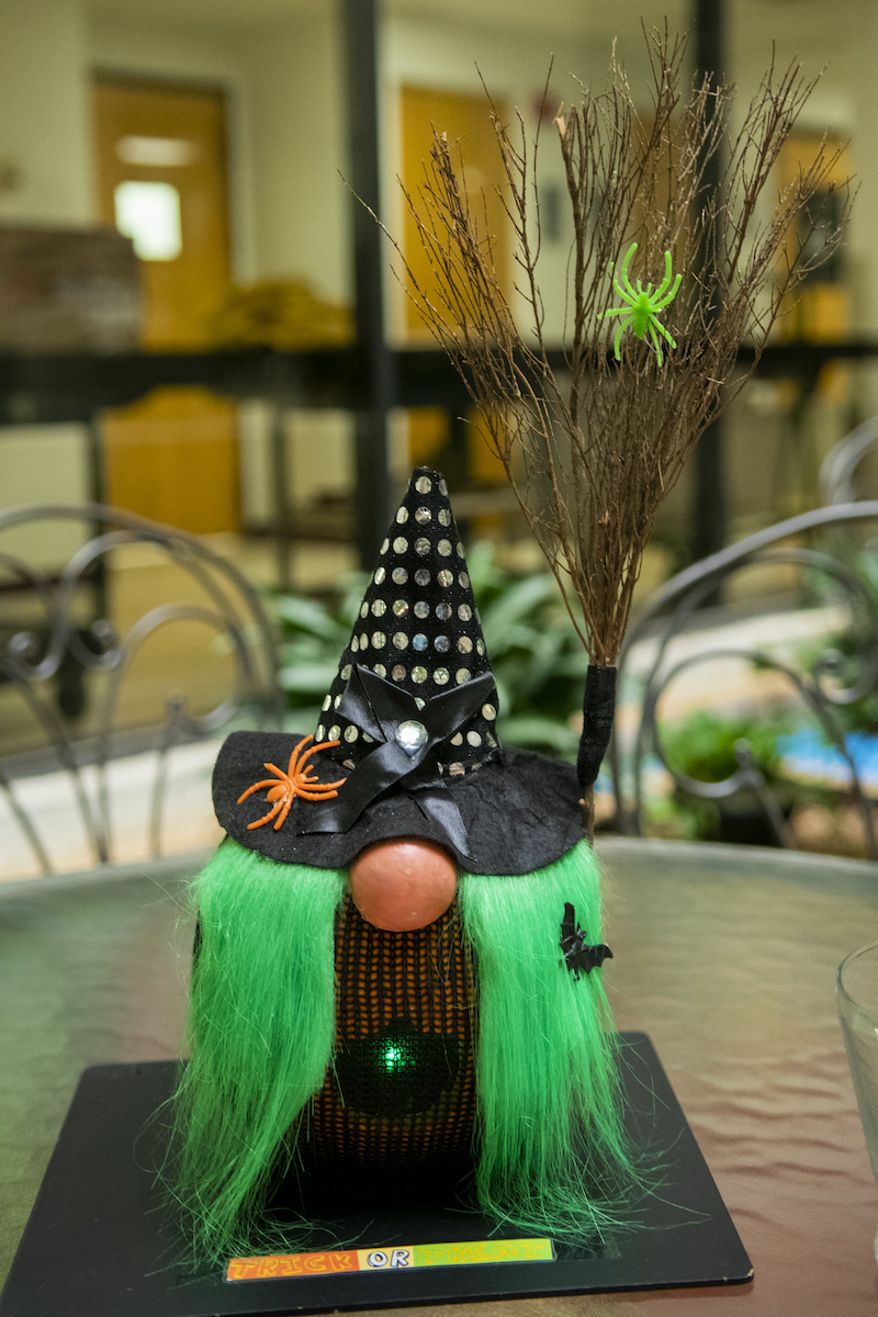 pumpkin carved like a green haired gnome