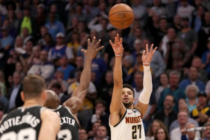 Jamal Murray of the Denver Nuggets puts up three points against the San Antonio Spurs on April 16, 2019 in Denver.