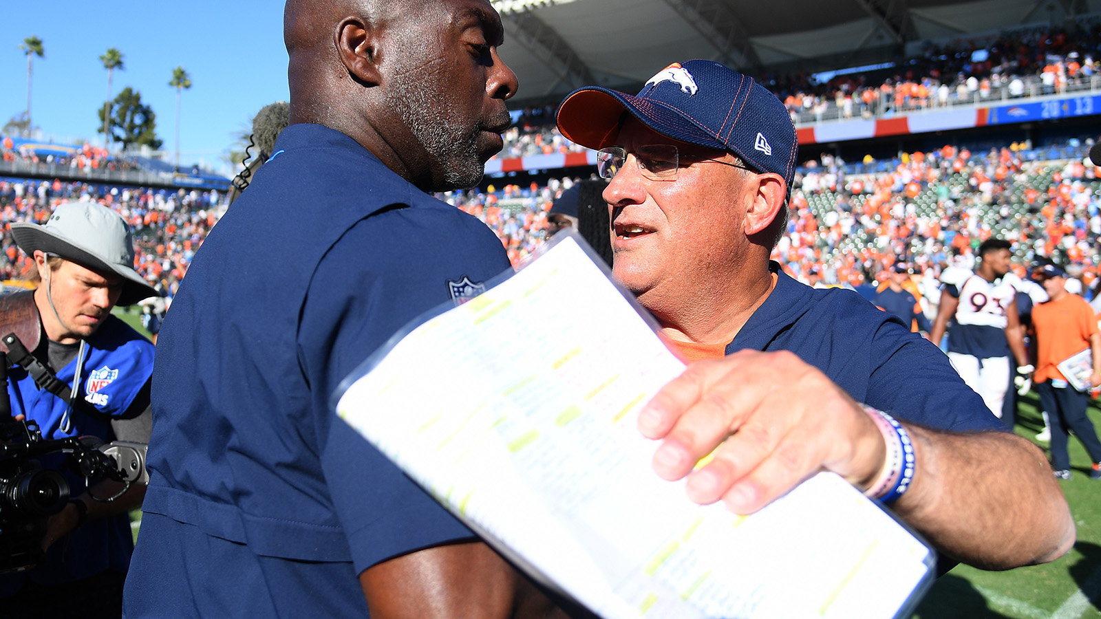 Head coach Vic Fangio of the Denver Broncos and head coach Anthony Lynn of the Los Angeles Chargers meet after a 20-13 Broncos win at Dignity Health Sports Park on Oct. 6, 2019.
