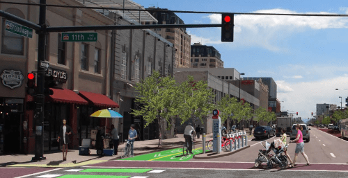 A rendering of what a two-way parking-protected bike lane might look like on lower Broadway. Image: City and County of Denver