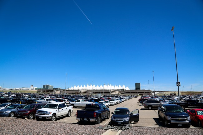 A sea of car storage in extends until it reaches four massive parking structures. Image: Denver International Airport