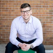 Ian Palombo of Denver sits on a bench outside of Mental Health Collective