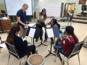 music students getting help from Denver Municipal Band