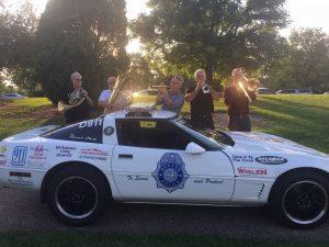 shane endsley with denver police car in pinecrest