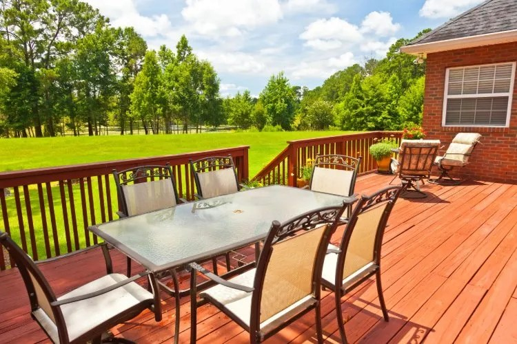 deck vs patio the pros and cons