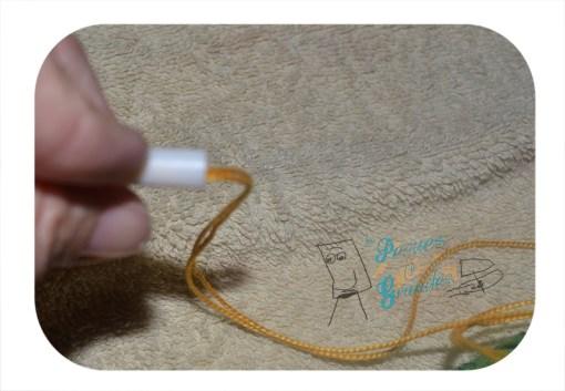 cuerda pasando por varilla