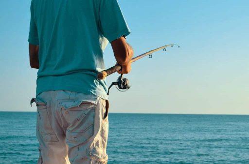 Pescador oceano de pesca y anzuelo