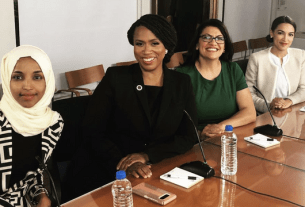 Fact Check: Did Congresswomen take photo seated in front of ISIS flag and picture of Osama Bin Laden?