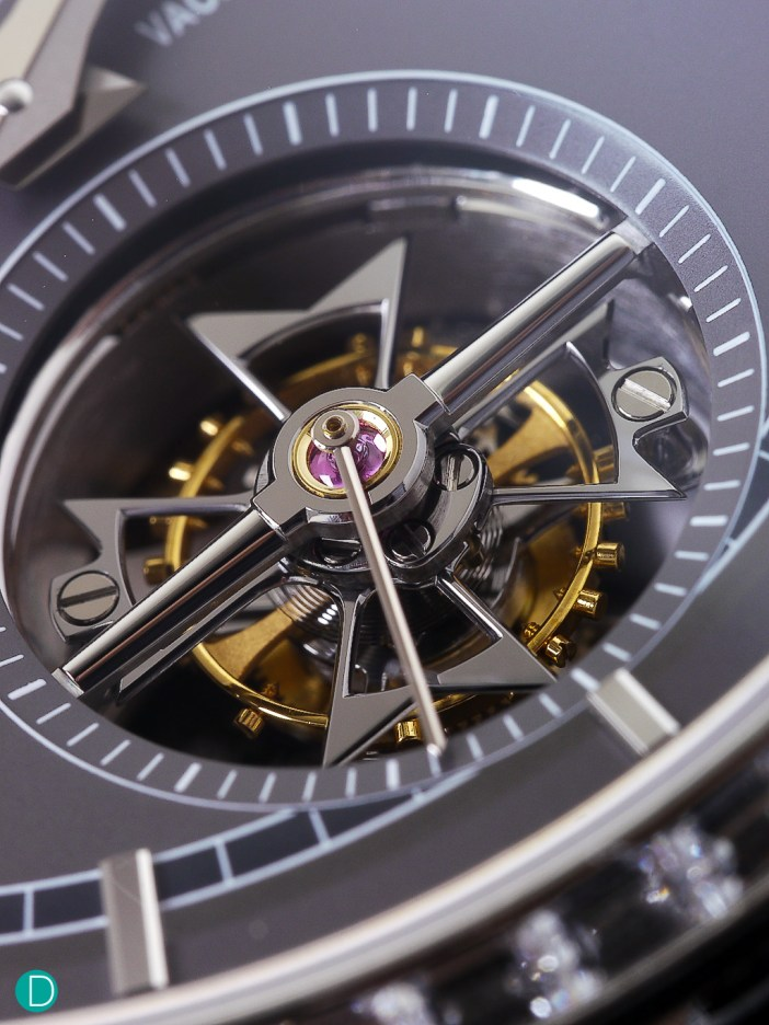 A better look at the tourbillon cage, featuring a black finish Maltese cross, and conical shaped arms.
