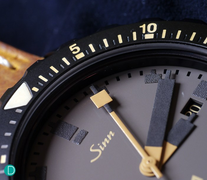 Highly legible hands and markers with thick lume, a useful feature for divers.