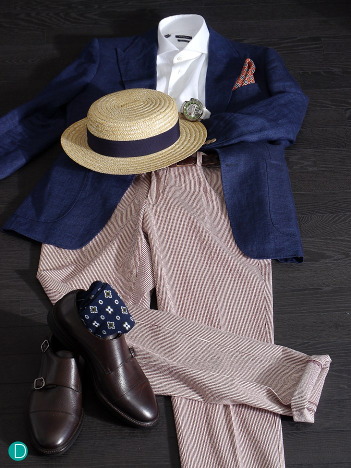 This ensemble is decidedly casual, with linen coat, linen shirt, and seersucker trousers, and even a boater hat. The watch is the iconic and nautically flavoured HYT H1 Titanium with a gorgeous white strap.