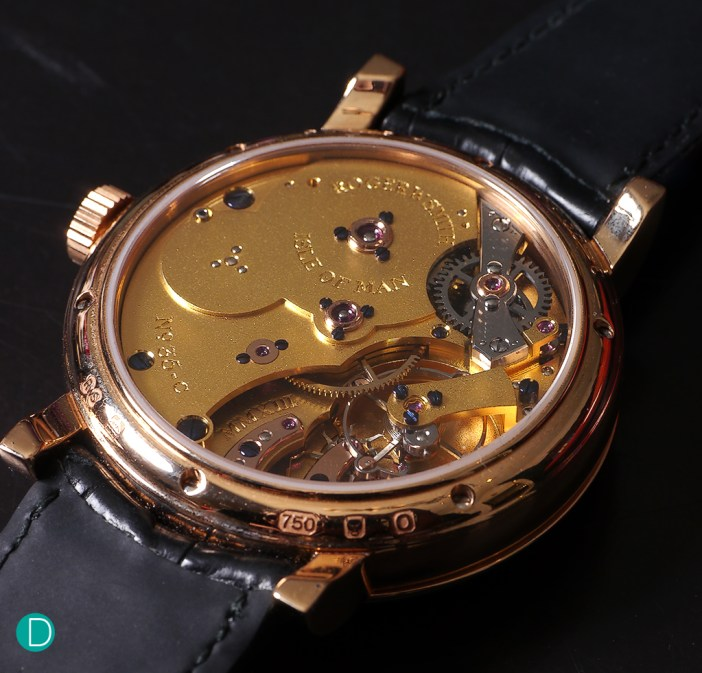 The movement is gilt finished and features the Daniels Coaxial escapement.
