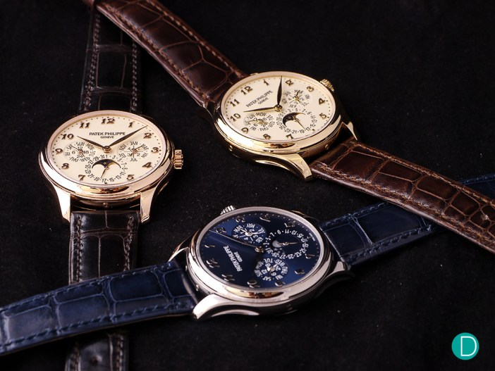 The Patek Philippe Ref. 5327 in rose and yellow gold, and the Ref. 5140 in platinum.