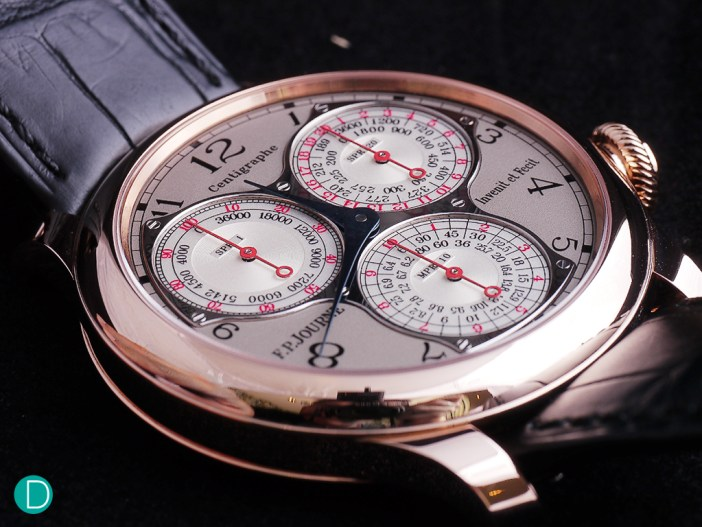 The Centigraphe sports three beautifully-designed sub dials that indicates elapsed times from a 100th of a second to 10 minutes. Each sub dial has a time scale in red and a tachometer scale in black.
