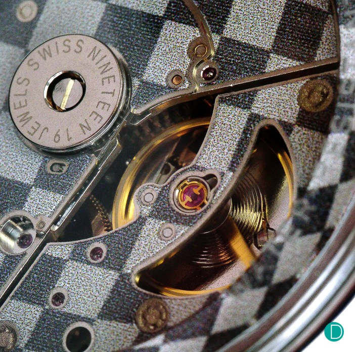 The openwork caseback design of the watch allows for a clear view of the movement.