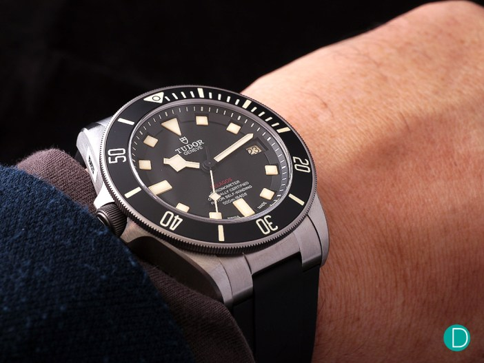 The standard wristshot. If held such that the watch is vertical, the un-common position (in a regular watch) of crown right is encountered. This is un-common because it requires the wrist to be rolled towards the body, and is not a naturally occurring stance. For the destro watches, crown left is similarly low in occurrence and hence not typically adjusted for.