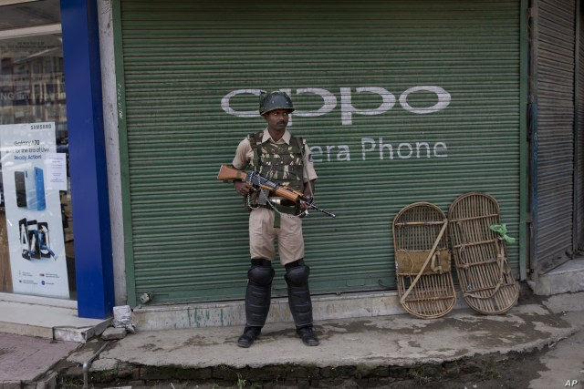 An Indian paramilitary soldier stands guard in Srinagar, Indian controlled Kashmir, Friday, Aug. 2, 2019. An Indian soldier was killed during a gunbattle with rebels in Kashmir on Friday as residents panicked over reports of India's deployment of…