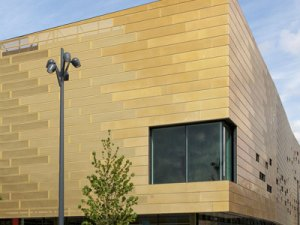 A view of the Deptford Lounge from the front showing golden cladding