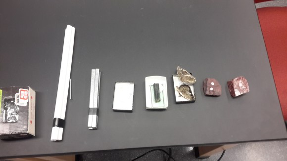 Materials tested in the air-core coil. From left to right: Nails, Teflon, optical calcite, tremolite, phlogopite (Mg-rich biotite).