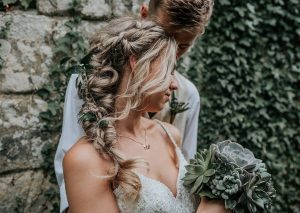 Bridal up-do with hair cascading over her right shoulder