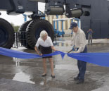 HR Director Diane Diedrick assists Vitor Quintino with the ribbon-cutting