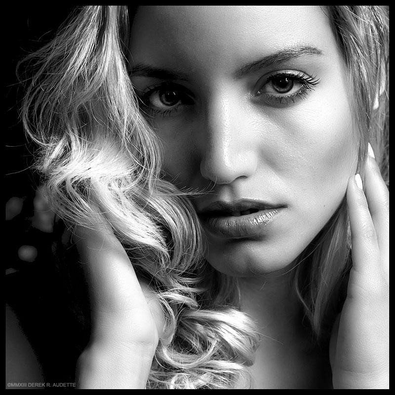 Closeup portrait of beautiful young blonde woman