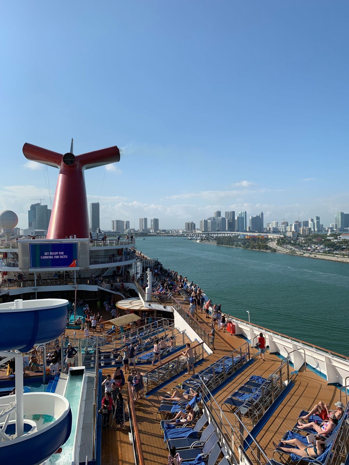 Carnival Victory leaving PortMiami with Miami in the background.
