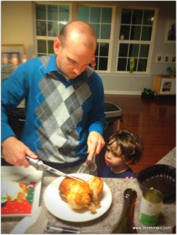 David watching his daddy carve
