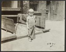 Barefoot Boy On Sidewalk