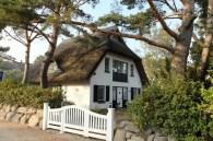 Reet-gedeckte Häuser