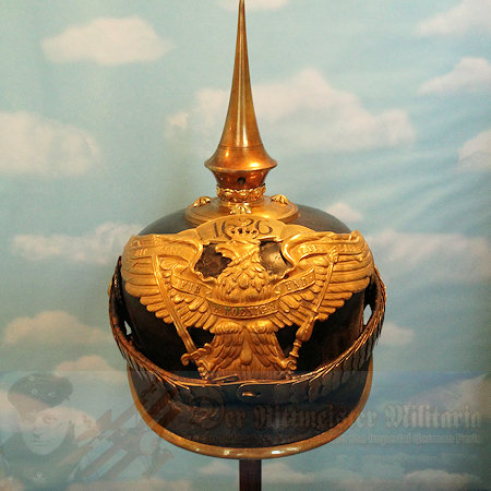 """This is a spike helmet for an officer in Grenadier Regiment 4 in the 1911 – 1914 period. Officially it was known as Grenadier-Regiment König Friedrich der Große (3. Ostpreußches) Nr 4. This regiment was founded in 1626 and was garrisoned at Rastenberg in East Prussia, where it was attached to the Prussian I. Armeekorp. . The helmet originally took the Heraldic Eagle with the shorter wings and FWR on its breast. A large banner above the eagle inscribed with the number """"1626 was awarded by AKO on 6 Nov 1888, to commemorate the date that the regiment was activated. Grenadier-Regiment Nr 4 was the oldest regiment in the Imperial Army, and the Kaiser chose to honor the unit with the addition of its activation date on its helmet plate. The short winged style plate was worn until 1 May 1911 when it was replaced with the wide winged Grenadier Eagle shown on this helmet."""