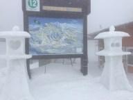 Snow lanterns near a map at lift 12