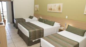vicino-al-mare-hotel-no-guaruja-enseada-suite-quadruplo