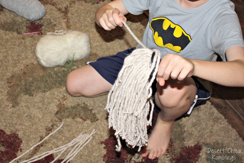 Pull mop strings out for stick horse