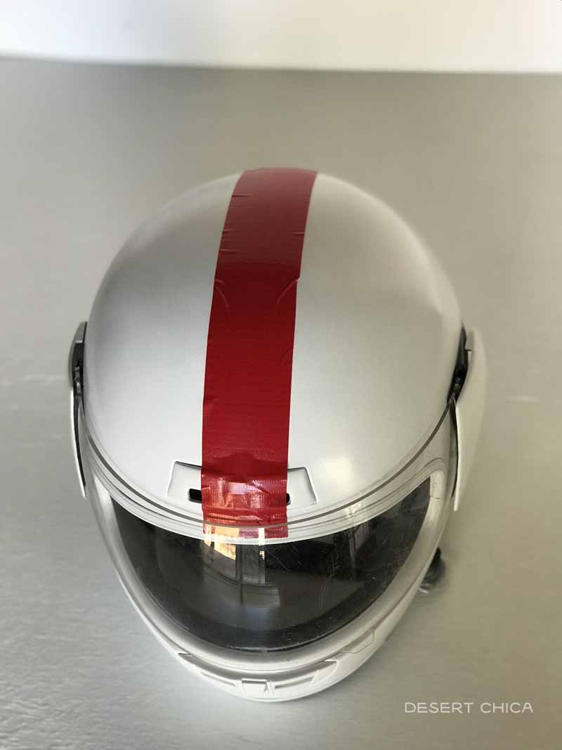 white motorcycle helmet with red stripe