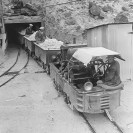 Borax Mines - Ore arriving from the Widow Mine at portal of Upper Biddy tunnel. Engineer Luckhurst, passengers Left, Norman Ross, right, Harry P. Gower - Courtesy National Park Service, Death Valley National Park