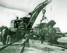 """The """"Francis"""" locomotive being loaded in Dagget in 1914 for shipment to Death Valley via Ludlow for use with the DVRR - Courtesy National Park Service, Death Valley National Park"""
