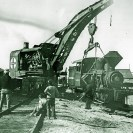 "The ""Francis"" locomotive being loaded in Dagget in 1914 for shipment to Death Valley via Ludlow for use with the DVRR - Courtesy National Park Service, Death Valley National Park"