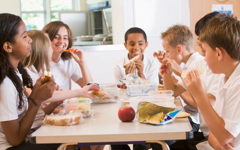 feeding on the Word showing kids on the Table