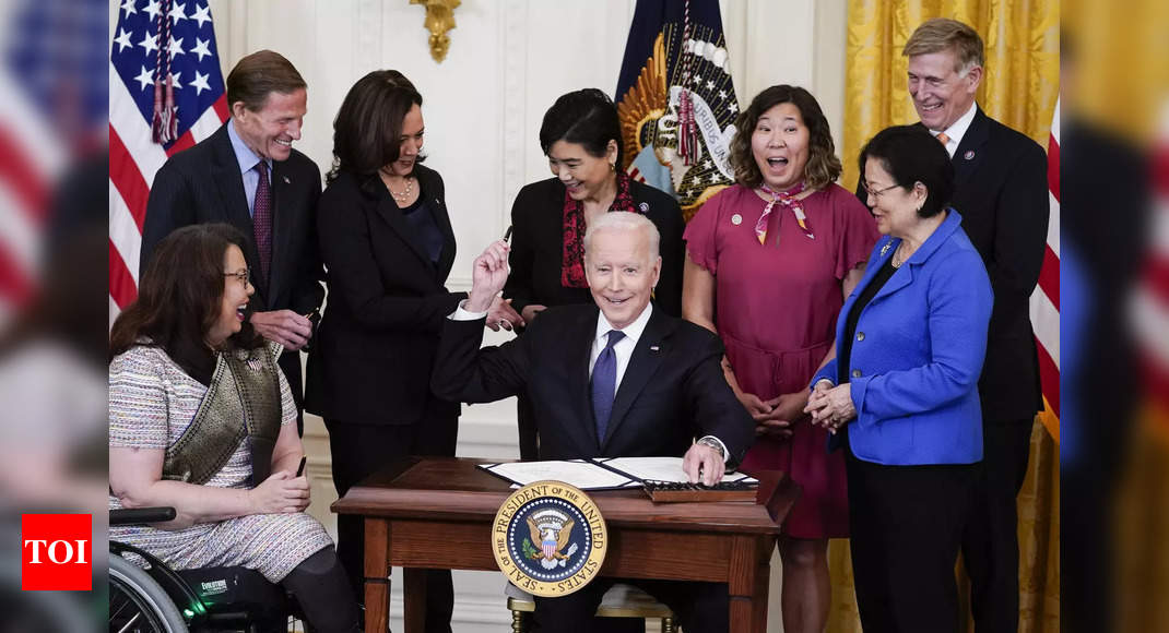 Biden, saying 'silence is complicity,' signs Covid hate crimes bill into law