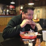 Joel bites into the long awaited brisket sandwich at Southern Smokehouse Lafayette, IN